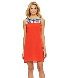 Coral dress with navy detail! Super cute!